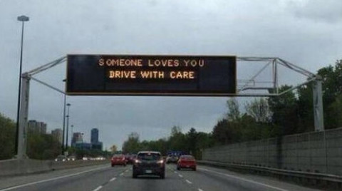 highwaysign_someonelovesyoudrivewithcare_ats-twitter_011915-e1421884414459